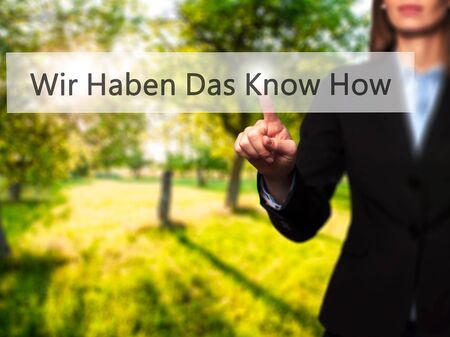knowhow: Wir Haben Das Know How! (We Have the Know-How in German) - Businesswoman pressing high tech  modern button on a virtual background. Business, technology, internet concept. Stock Photo