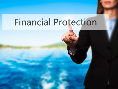 financial protection: Financial Protection - Businesswoman pressing high tech  modern button on a virtual background. Business, technology, internet concept. Stock Photo
