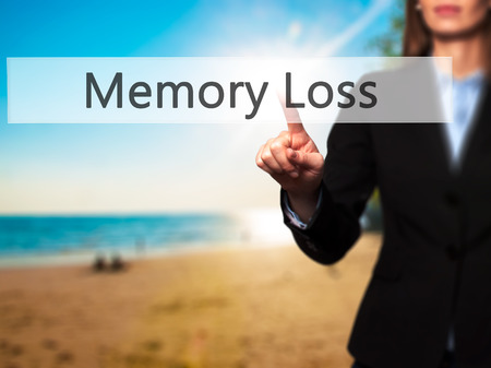 memory loss: Memory Loss - Businesswoman pressing high tech  modern button on a virtual background. Business, technology, internet concept. Stock Photo