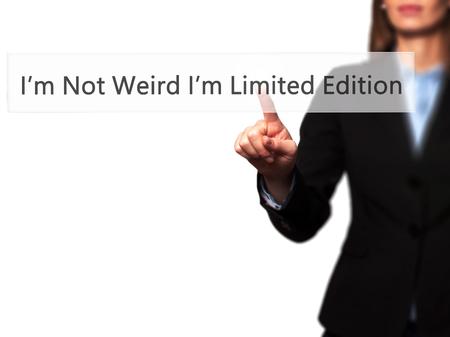 wacky: Im Not Weird Im Limited Edition - Businesswoman pressing high tech  modern button on a virtual background. Business, technology, internet concept. Stock Photo