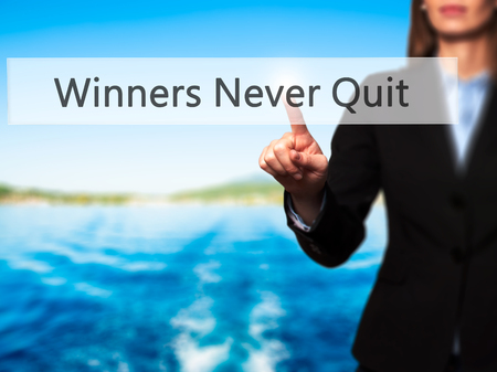 persevere: Winners Never Quit - Businesswoman pressing high tech  modern button on a virtual background. Business, technology, internet concept. Stock Photo