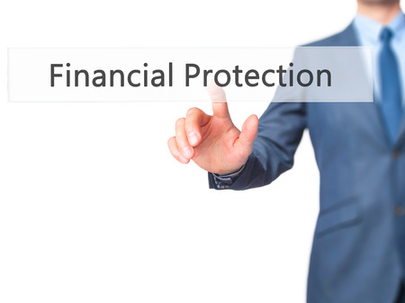 financial protection: Financial Protection - Businessman hand touch  button on virtual  screen interface. Business, technology concept. Stock Photo Stock Photo