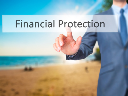 secret society: Financial Protection - Businessman hand touch  button on virtual  screen interface. Business, technology concept. Stock Photo Stock Photo