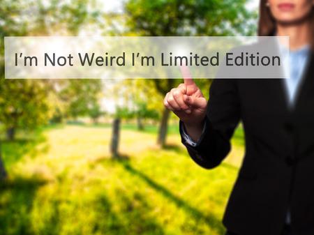 advise: Im Not Weird Im Limited Edition - Businesswoman pressing high tech  modern button on a virtual background. Business, technology, internet concept. Stock Photo