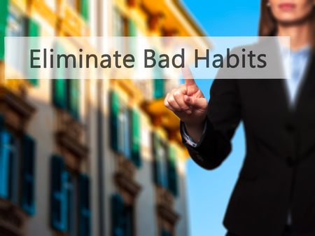 eliminate: Eliminate Bad Habits - Businesswoman pressing high tech  modern button on a virtual background. Business, technology, internet concept. Stock Photo Stock Photo