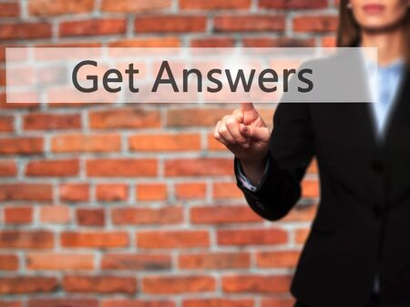 istruzione: Get Answers - Businesswoman pressing high tech  modern button on a virtual background. Business, technology, internet concept. Stock Photo