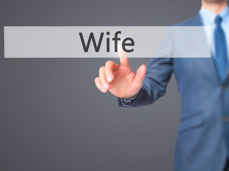 ex wife: Wife - Businessman hand touch  button on virtual  screen interface. Business, technology concept. Stock Photo