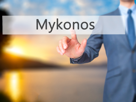 Mykonos - Businessman hand touch  button on virtual  screen interface. Business, technology concept. Stock Photo Stock Photo