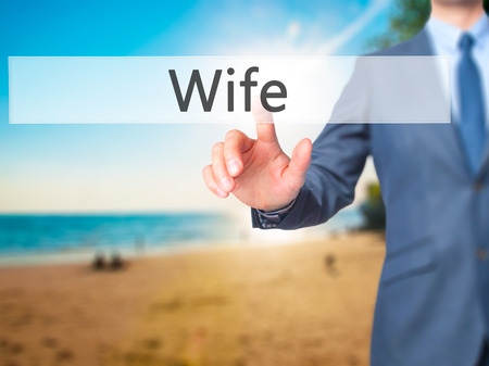 ex husband: Wife - Businessman hand touch  button on virtual  screen interface. Business, technology concept. Stock Photo