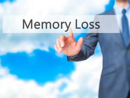 degenerative: Memory Loss - Businessman hand touch  button on virtual  screen interface. Business, technology concept. Stock Photo