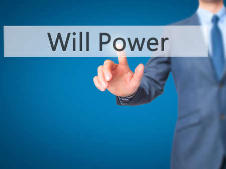 will power: Will Power - Businessman hand touch  button on virtual  screen interface. Business, technology concept. Stock Photo Stock Photo