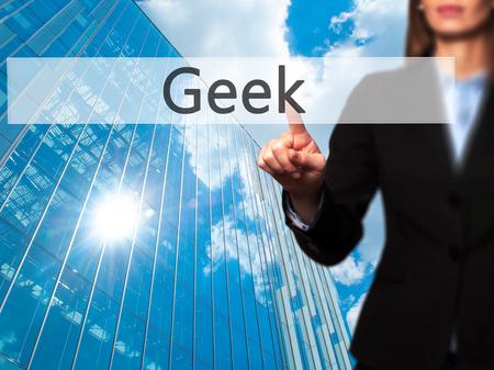 Geek - Businesswoman pressing high tech  modern button on a virtual background. Business, technology, internet concept. Stock Photo