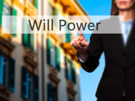 will power: Will Power - Businesswoman pressing high tech  modern button on a virtual background. Business, technology, internet concept. Stock Photo Stock Photo