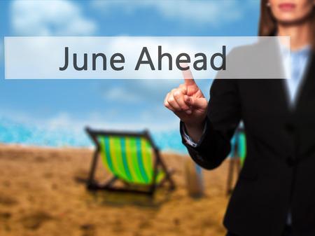 June Ahead - Businesswoman pressing high tech  modern button on a virtual background. Business, technology, internet concept. Stock Photo