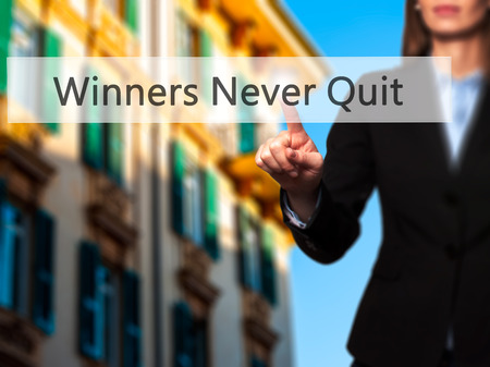 persist: Winners Never Quit - Businesswoman pressing high tech  modern button on a virtual background. Business, technology, internet concept. Stock Photo