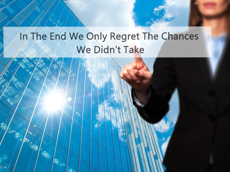 remorse: In The End We Only Regret The Chances We Didnt Take - Businesswoman pressing high tech  modern button on a virtual background. Business, technology, internet concept. Stock Photo Stock Photo