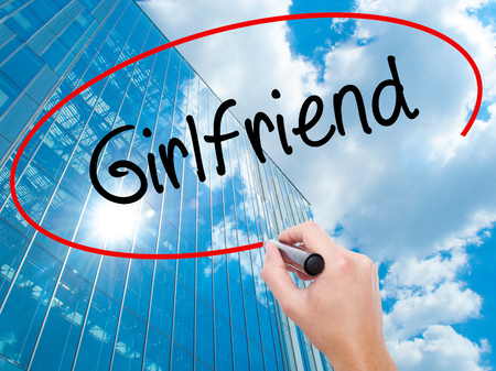 Man Hand writing Girlfriend with black marker on visual screen. Business, technology, internet concept. Stock Photo