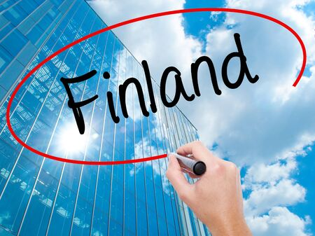 Man Hand writing Finland with black marker on visual screen.  Business, technology, internet concept. Stock  Photo