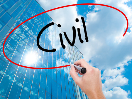 seize: Man Hand writing Civil with black marker on visual screen.  Business, technology, internet concept. Modern business skyscrapers background. Stock Photo