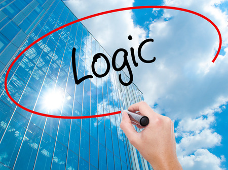 l�gica: Man Hand writing Logic with black marker on visual screen. Business, technology, internet concept.