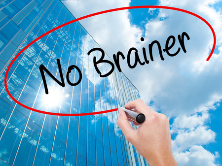 Man Hand writing No Brainer with black marker on visual screen. Business, technology, internet concept. Stock Photo