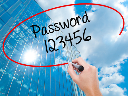 Man Hand writing Password 123456 with black marker on visual screen. Business, technology, internet concept.
