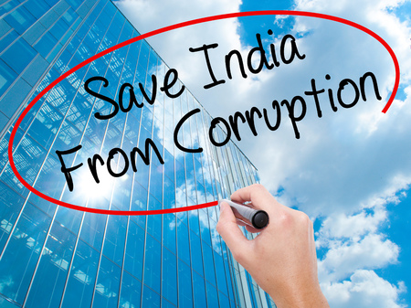 marchers: Man Hand writing Save India From Corruption with black marker on visual screen.  Business, technology, internet concept. Modern business skyscrapers background. Stock Photo