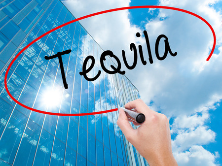 drunken: Man Hand writing Tequila with black marker on visual screen. Business, technology, internet concept.