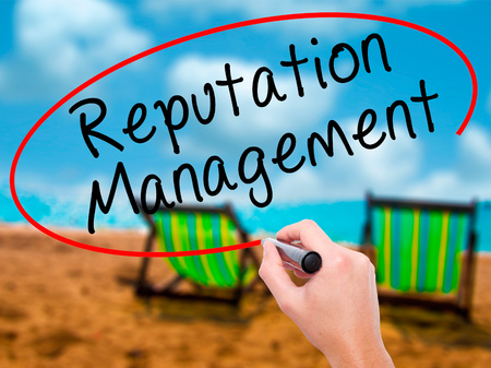 Man Hand writing Reputation Management with black marker on visual screen. Isolated on sunbed on the beach. Business, technology, internet concept. Stock Image Stock Photo
