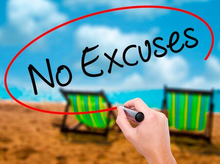 Man Hand writing No Excuses  with black marker on visual screen. Isolated on sunbed on the beach. Business, technology, internet concept. Stock Photo Stock Photo