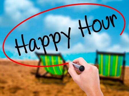 happyhour: Man Hand writing Happy Hour with black marker on visual screen. Isolated on sunbed on the beach. Business, technology, internet concept. Stock Image Stock Photo