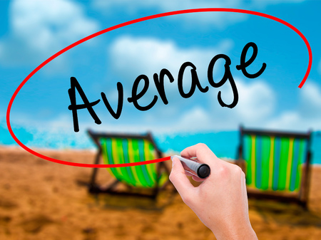 median: Man Hand writing Average with black marker on visual screen. Isolated on sunbed on the beach. Business, technology, internet concept. Stock Photo