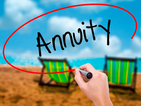 variable rate: Man Hand writing Annuity with black marker on visual screen. Isolated on sunbed on the beach. Business, technology, internet concept. Stock Photo Stock Photo