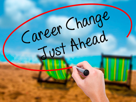 challenges ahead: Man Hand writing Career Change Just Ahead with black marker on visual screen. Isolated on sunbed on the beach. Business, technology, internet concept. Stock Photo