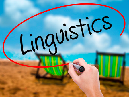 Man Hand writing Linguistics  with black marker on visual screen. Isolated on sunbed on the beach. Business,  technology, internet concept. Stock Photo Reklamní fotografie