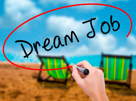 luxacion: Man Hand writing Dream Job with black marker on visual screen. Isolated on sunbed on the beach. Business, technology, internet concept. Stock Image Foto de archivo
