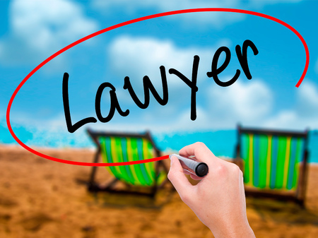 lawer: Man Hand writing Lawyer with black marker on visual screen. Isolated on sunbed on the beach. Business, technology, internet concept. Stock Photo Stock Photo
