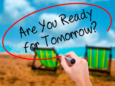 Man Hand writing Are You Ready for Tomorrow? with black marker on visual screen. Isolated on sunbed on the beach. Business, technology, internet concept. Stock  Photo Stock Photo