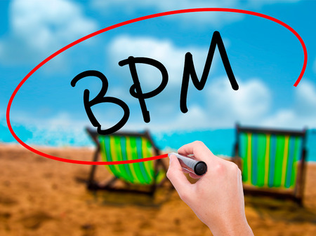 bpm: Man Hand writing  BPM (Business Process Management) with black marker on visual screen. Isolated on sunbed on the beach. Business, technology, internet concept. Stock Photo Stock Photo