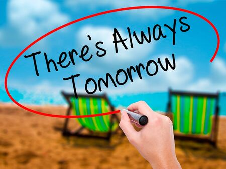 Man Hand writing Theres Always Tomorrow  with black marker on visual screen. Isolated on sunbed on the beach. Business, technology, internet concept. Stock Photo