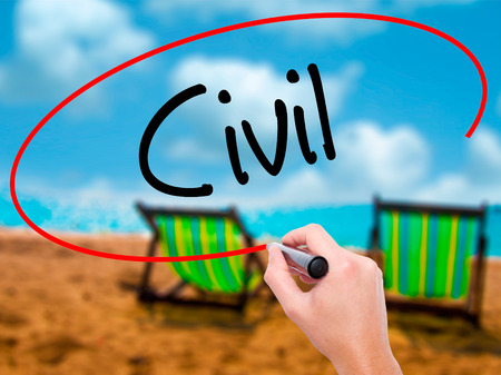 seizing: Man Hand writing Civil with black marker on visual screen. Isolated on sunbed on the beach. Business, technology, internet concept. Stock Photo