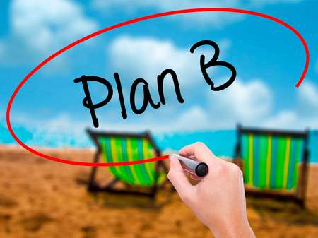 Man Hand writing Plan B with black marker on visual screen. Isolated on sunbed on the beach. Business, technology, internet concept. Stock Photo