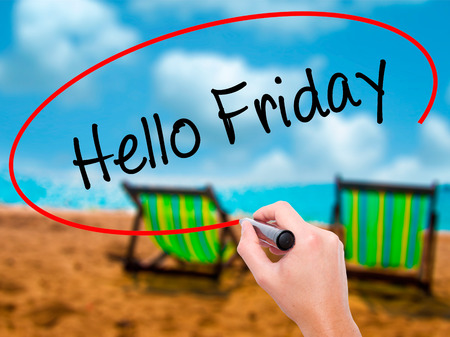 Man Hand writing Hello Friday with black marker on visual screen. Isolated on sunbed on the beach. Business, technology, internet concept. Stock Photo Stock Photo