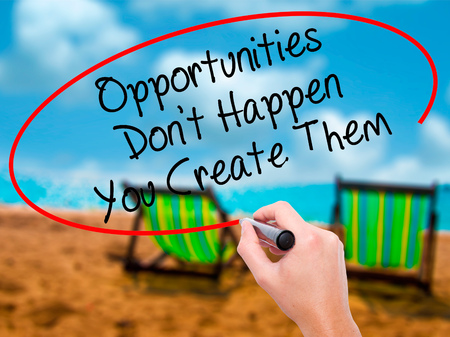 street wise: Man Hand writing Opportunities Dont Happen You Create Them with black marker on visual screen. Isolated on sunbed on the beach. Business, technology, internet concept. Stock Photo Stock Photo