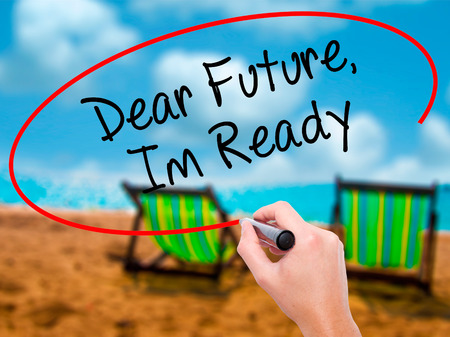 Man Hand writing Dear Future, Im Ready with black marker on visual screen. Isolated on sunbed on the beach. Business, technology, internet concept. Stock Photo