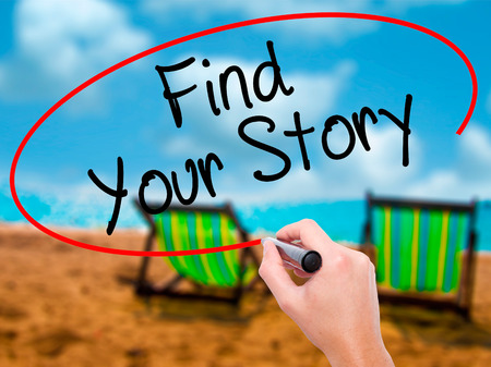 personality development: Man Hand writing Find Your Story with black marker on visual screen. Isolated on sunbed on the beach. Business, technology, internet concept. Stock Photo Stock Photo