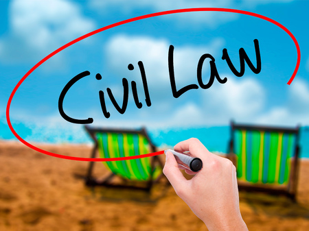 obligations: Man Hand writing Civil Law with black marker on visual screen. Isolated on sunbed on the beach. Business, technology, internet concept.