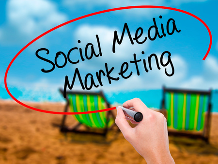 tumblr: Man Hand writing Social Media Marketing with black marker on visual screen. Isolated on sunbed on the beach. Business, technology, internet concept. Stock Photo Stock Photo