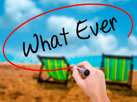 ignorant: Man Hand writing What Ever  with black marker on visual screen. Isolated on sunbed on the beach. Business, technology, internet concept. Stock Photo Stock Photo