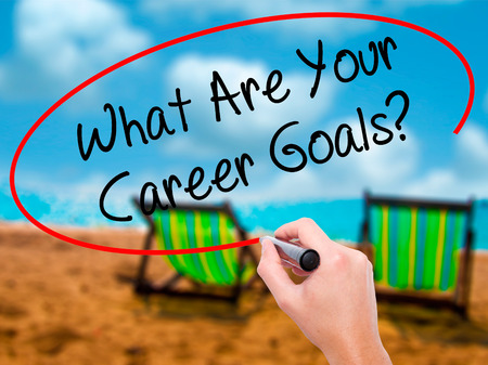 Man Hand writing What Are Your Career Goals? with black marker on visual screen. Isolated on sunbed on the beach. Business, technology, internet concept. Stock Photo Stock Photo